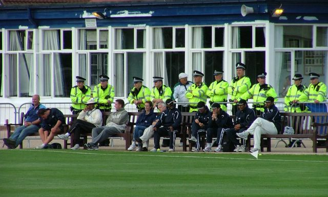 The police earn their overtime while Accies and France occupy the benches in front.