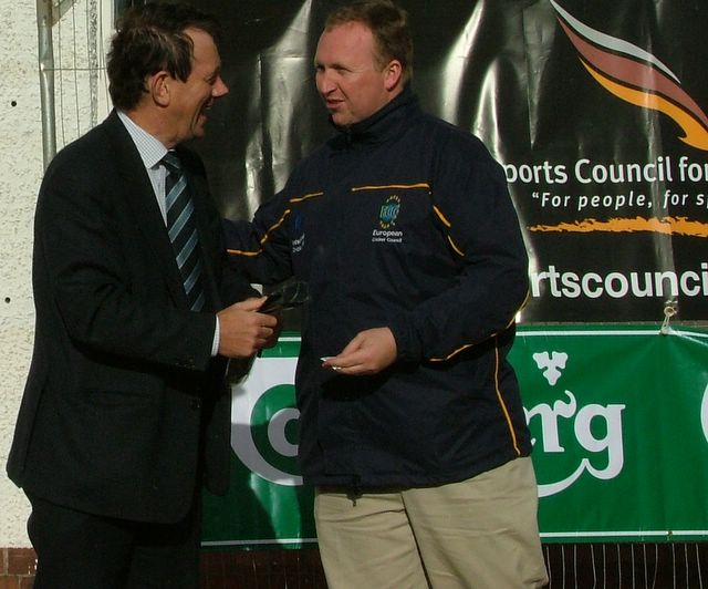 Accies' President George McLaren accepts another tie on behalf of the club.