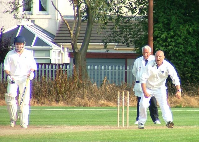 NG Campbell trying to scare the batsman with Umpire deep in concentration