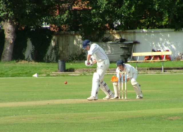 Dan, now with huge experience of playing Sunday cricket hungover, watches the ball closely