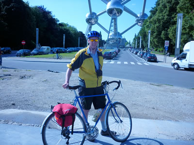 Alex Dowers poses in front of the Atomium in Brussels